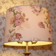 Colorful lampshade on the background of motley wallpaper — Stock Photo