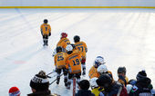 The team of boys coming out on the ice to play hockey in honor of the opening of the new rink. Irkutsk — Stock Photo