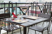 Wet empty table at an outdoor cafe during a rainstorm — Stock Photo
