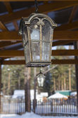 Cast iron lantern on the verandah of country house — Stock Photo