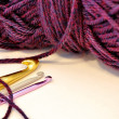 Crochet hooks and purple yarn — Stock Photo