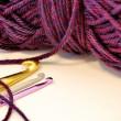 Crochet hooks and purple yarn — Stock Photo