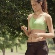Sports activity, attractive young woman with mp3 player — Stock Video