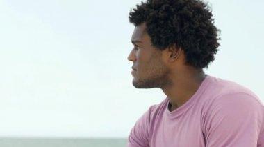Young cuban man smiling at camera — Stock Video