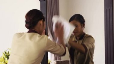 Portrait of happy Asian housekeeper at work — Stock Video