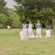 Stock Video: Teacher and group of school children having fun