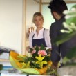 Young woman working as florist giving receipt — Stock Video