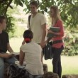 Friends studying together, group of four university students meeting — Vídeo de stock
