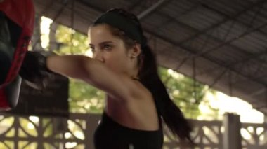 Beautiful young female athlete exercising for self-defense in boxing gym — Stock Video