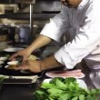 Close-up of chef hands cooking and preparing Asian food - Foto Stock