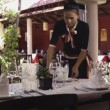 Attractive young woman working as waitress in exclusive restaurant, setting up a table. — Stock Video #21813499