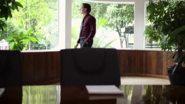 Worried young business man looks out of the office window at work — Stock Video