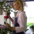 Young attractive woman working in flower shop — Stock Video