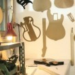 Inside view of guitar workshop with musical instruments and tools - Stock Photo