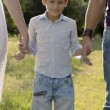 Father and son holding hands in park — Stock Video #22315665