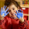 Happy children having fun and painting with hands in kindergarten.  — Stock Video