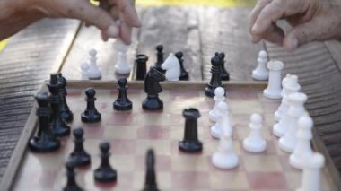 Two senior men playing chess at park — Stock Video