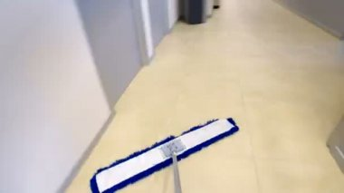 Time-lapse of professional cleaner wiping floor with mop in industrial building — Stock Video