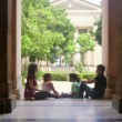 Students in university, group of young men and women talking — Stock Video #25087113