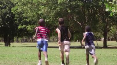 Children running and playing, group of friends in city park — Stock Video