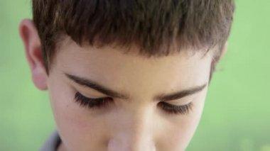 Portrait of sad young hispanic kid looking at camera — Stock Video