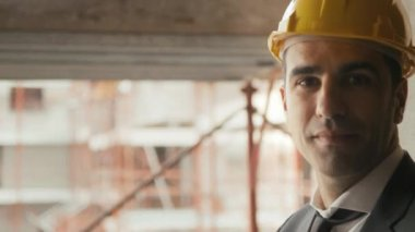 Professional at work, portrait of happy and confident architect with safety helmet in construction site, smiling at camera — Stock Video