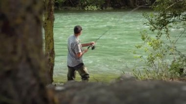 Fisherman on holidays on river, relaxing and fishing. — Stock video