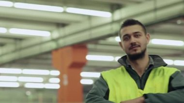 Portrait of man employed in logistics facility smiling at camera — Stock Video