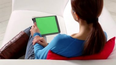Asian girl using touch pad device — Stock Video