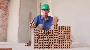 22of23 Building activity with asian man working with bricks — Stock Video