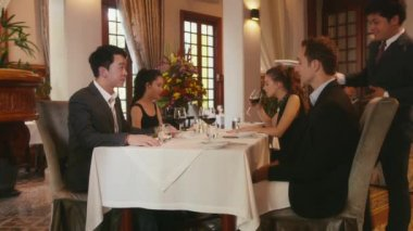 16of26 People eating at restaurant, business dinner, men, women — Stock Video