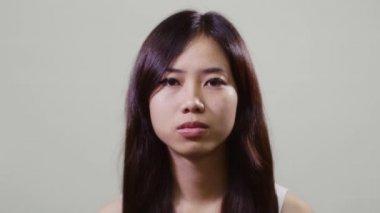 Sad Asian teenager — Stock Video