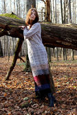 The girl in beautiful long wool knitted dress — Stok fotoğraf