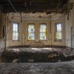 Hole in floor near four beautiful Vintage windows — Stock Photo