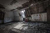 Attic in abandoned building — Stock Photo