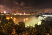 Night Landscape View on Niagara Falls and Bridge between USA and — Stock Photo