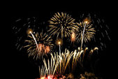 Colorful fireworks of various colors over night sky — Stock Photo
