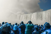 People under Niagara Falls — Stock Photo