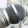 Microphone and money — Stock Photo #14095431