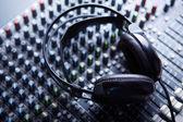 Headpnones on soundmixer — Stock Photo