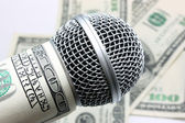 Microphone and money — Stock Photo