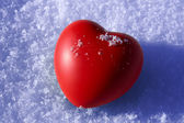 Heart on snow — Stock Photo