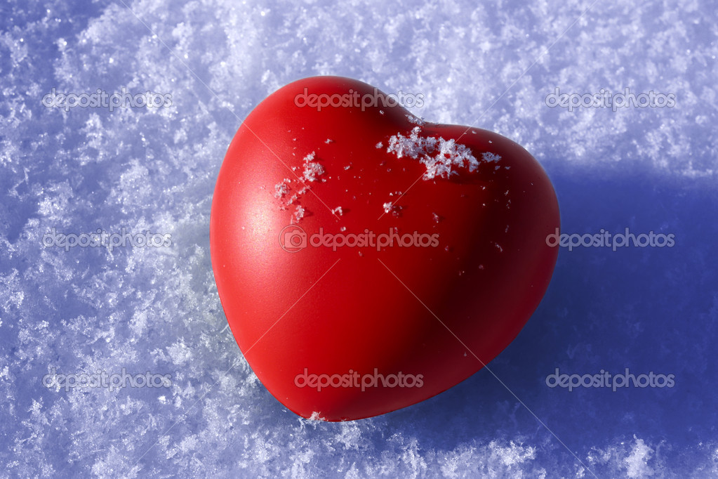 Red heart on snow — Stock Photo #14251435