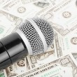 Microphone and money — Stock Photo #18600463