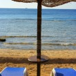 Two chairs and umbrella — Stock Photo
