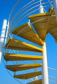 Yellow spiral ladder — 图库照片