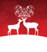 Two deer standing on a hill. One has horns in a shape of a heart. — Stock Vector