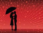 Silhouetten von mann und frau stehen und umarmt auf rotem grund. frau hält einen regenschirm. herzen regnen. — Stockvektor