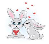 2 つのかわいいウサギ。1 つの心を持って. — ストックベクタ