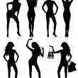 Collections of Vector silhouettes of a standing woman. — Stock Vector